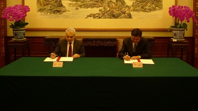 The signing of the cooperation agreement [source: IEA]