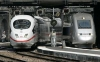 German ICE and a French TGV train arriving together in Paris