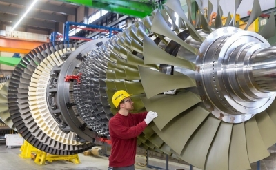 "Siemens warns of ""weaker"" industrial environment as profit falls"