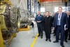 Dmitry Rogozin (left) and Alexey Miller (center) touring production workshops at Saturn factory in Rybinsk